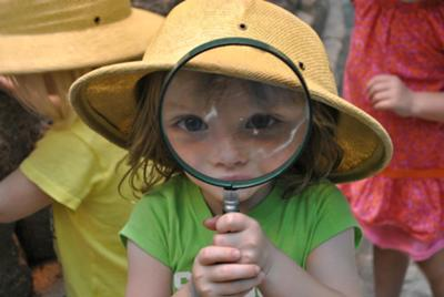 Girl with magnifying glass photo contest winne