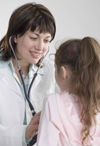 Doctor evaluating a little girl in regards to autism biomedical treatments