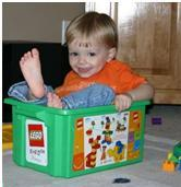 child in legos bucket receiving autism therapy