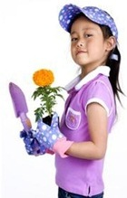 Little girl that is homeschooled due to school behavior problems holding gardening items