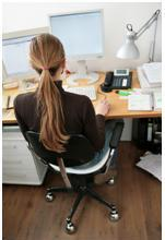 Lady on her computer engaging in google work from home while online