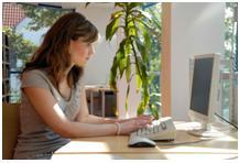 A woman on her computer engaged in online business work from home