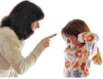 A mother scolding a child with oppositional defiant disorder