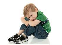 little boy on floor upset about potty training accidents