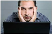 Man looking at computer upset by scam