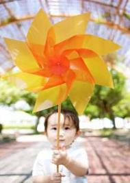 child with sensory disorder playing with pinwheel