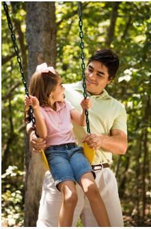 Dad swinging little girl for SPD treatment