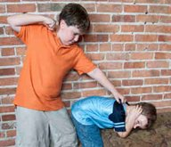 children displaying behavior disorders by fighting
