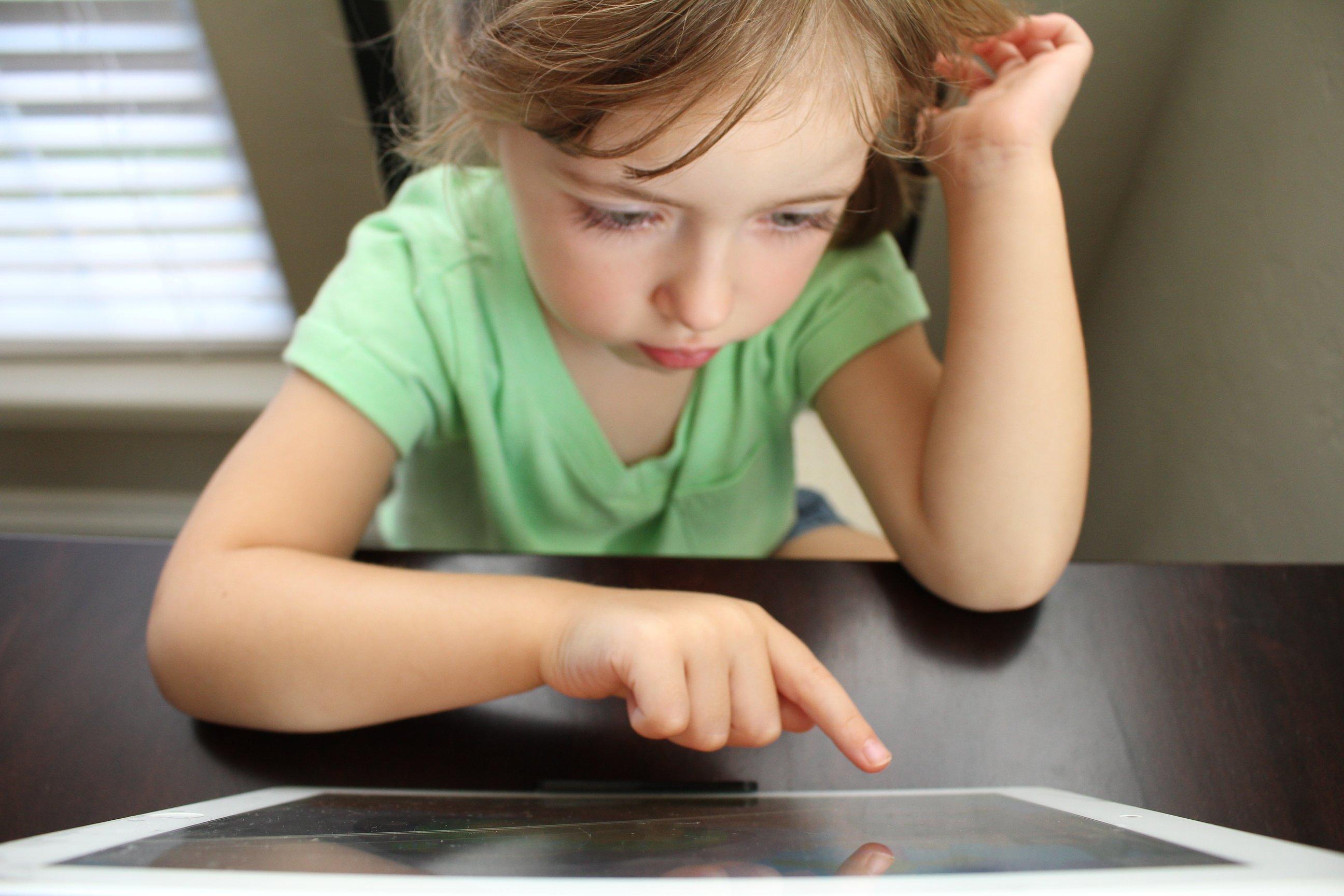 child on computer taking ADHD online test