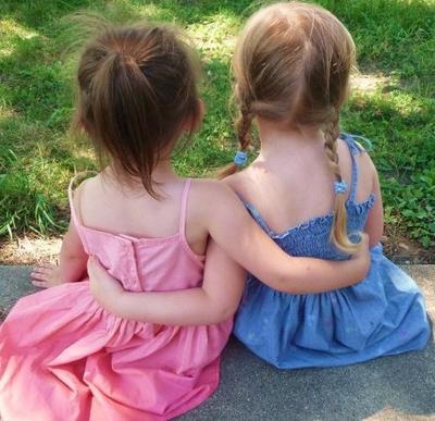 Little girls hugging photo contest winner