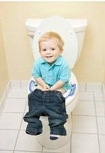 Little boy sitting on toilet learning for potty training a bowel movement