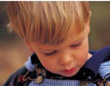 little boy staring into space showing signs of autism in toddlers