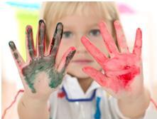 child with tactile dysfunction showing paint on her hands