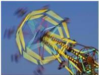 blurry picture of a ferris wheel indicating potentially having vestibular dysfunction